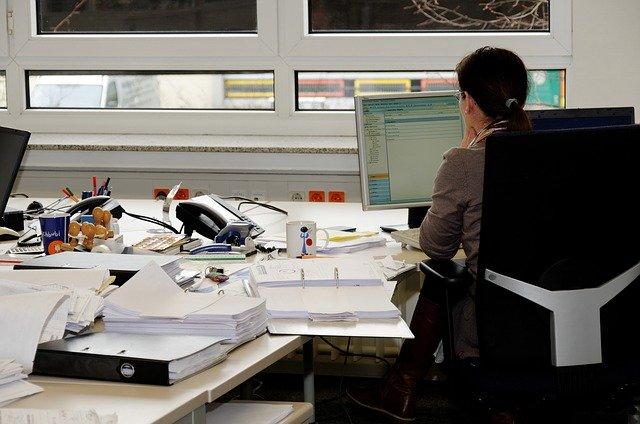secretary sitting at desk
